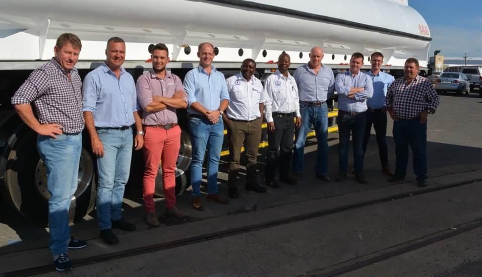 L to R : Mark Thomas (MD Zambulk); Philip van Rensburg (GM Zimbulk); Werner Venter (Afrit Cape Town Manager) ; Albert van de Wetering (Director Afrit); Henry Chisala (Transport Manager - Total Zambia); Mike Molongoti ( Head Supply and Transport -Total Zambia); Peter Bennetto (MD ReturnHauler); Joheine Els (Production Manager, Afrit Tanker Solutions); Marius Cronje (Head Engineer – Simera) ; Deon Prinsloo (MD, Afrit Tanker Solutions)